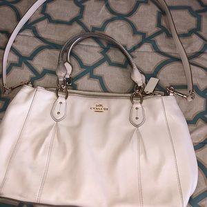 Cream Coach bag; heavy use